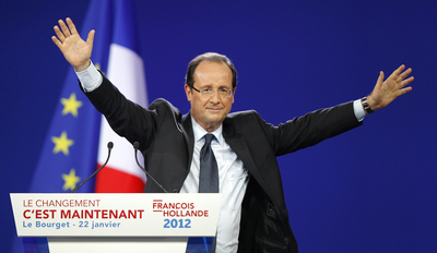 Francois Hollande, Socialist Party candidate for the 2012 French presidential election waves at the end of a political rally in Le Bourget near Paris
